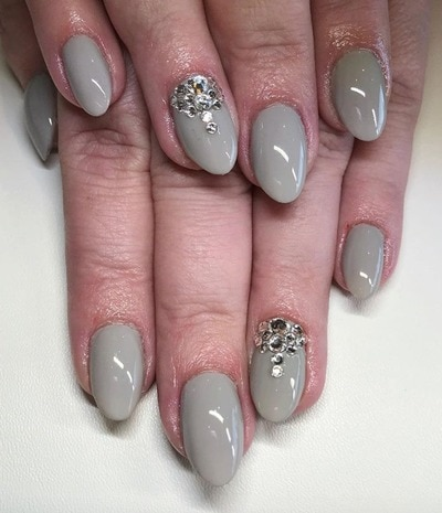 Natalie Walker adds a chic glimmer to this grey nail hue